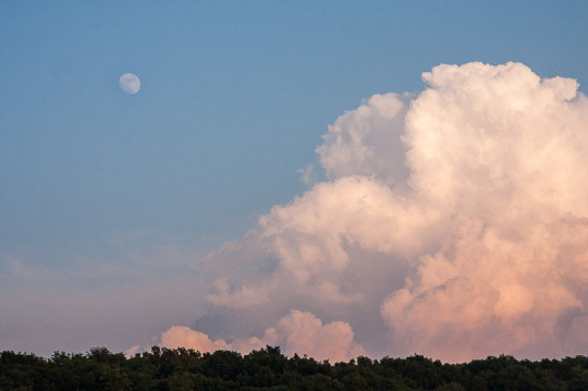 Daytime Moon over Storm Clouds